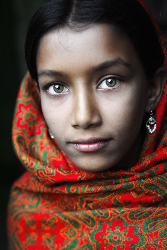 Girl with green eyes and red headscarf