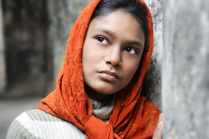 Girl In Orange Headscarf
