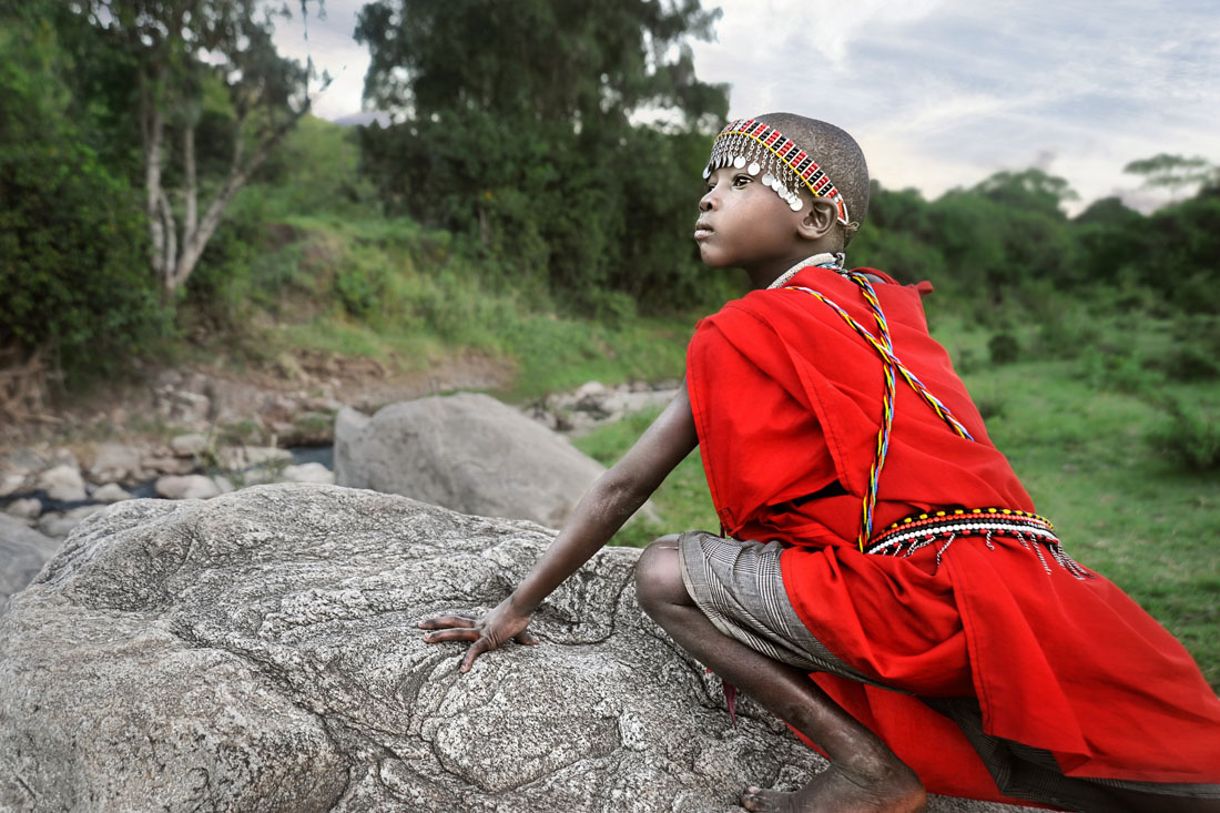 Masai Boy on a Rock