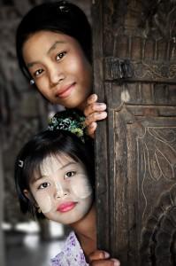Two Faces Behind a Teak Door