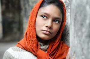 Girl In Orange Headscarf